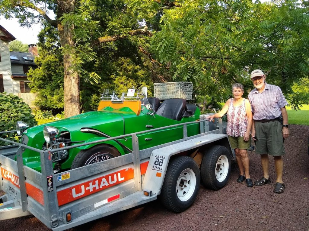 Mr Lomax posing next to his Lomax 223 on arrival at his home in the USA following shipment from the UK by Autoshippers